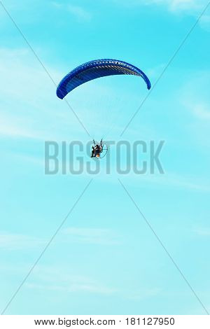 Warsaw, Poland - August 19, 2012: Paraglider flying over with the parachute in Poland
