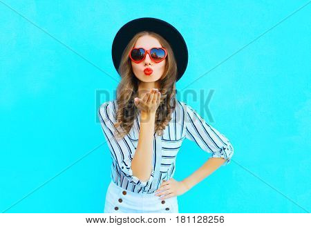 Fashion Portrait Pretty Woman With Red Lips Is Sends An Air Kiss In A Sunglasses Shape Of Heart Over