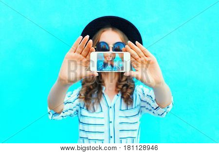 Fashion Woman Is Taking Photo Self Portrait On A Smartphone In The City Closeup Screen Over Colorful