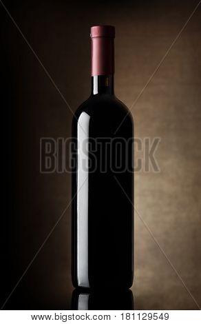 Black bottle of wine on a dark background