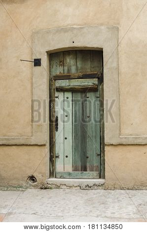 VAL'QUIRICO, TLAXCALA, MEXICO- MARCH 25, 2017: Facade with an ancient door in a street in Val'Quirico, a new town near to Tlaxcala, Mexico