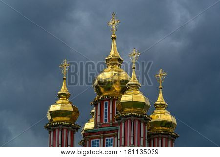 The orthodoxy church and thunderstorm dark blue sky
