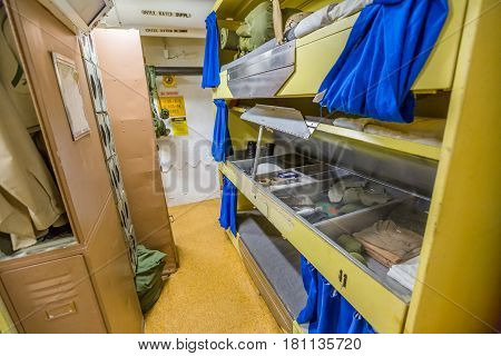 HONOLULU, OAHU, HAWAII, USA - AUGUST 21, 2016: officers bedroom with personal belongings closet and cots of Battleship Missouri at Pearl Harbor, a military Hawaiian port in Oahu island.