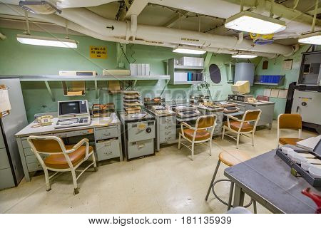 HONOLULU, OAHU, HAWAII, USA - AUGUST 21, 2016: big room with computers from 1980s of Battleship Missouri at Pearl Harbor. The end World War II was signed on this warship.