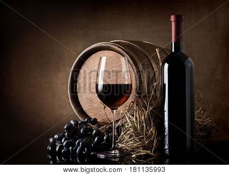 Wine with wooden barrel, hay and grape