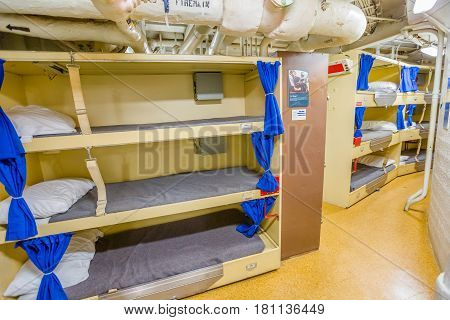 HONOLULU, OAHU, HAWAII, USA - AUGUST 21, 2016: Close up of cots in sailors bedroom with beds of Battleship Missouri at Pearl Harbor. National Historic Landmark.