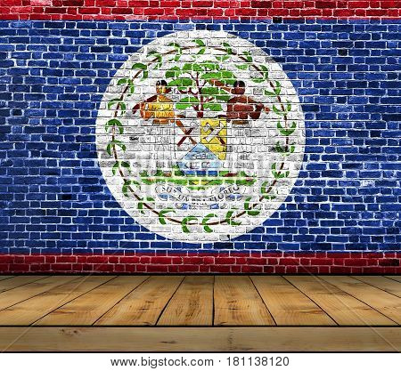 Belize flag painted on brick wall with wooden floor