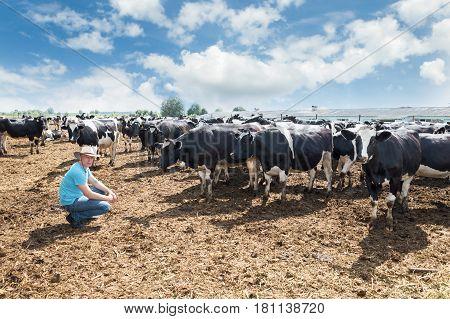 Farmer portrait against background of farm cows
