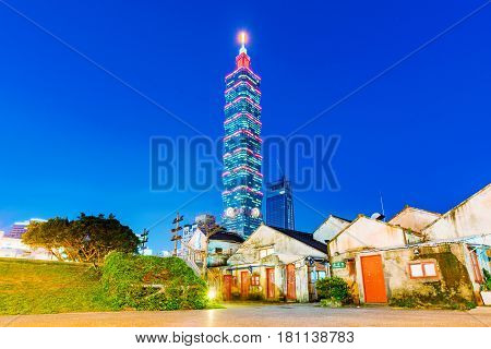 TAIPEI TAIWAN - MARCH 24: This is a view of Taipei 101 architecture and Military families community park in the Xinyi financial district on March 24 2017 in Taipei