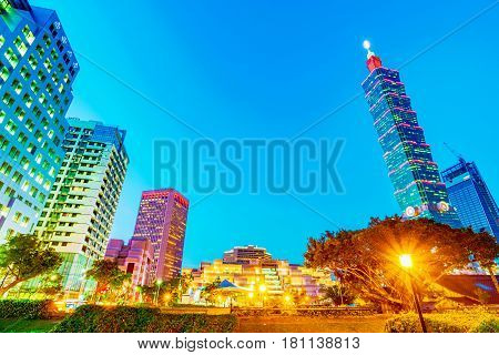 TAIPEI TAIWAN - MARCH 27: Night view of Xinyi financial district buildings taken from the Military families community park on March 27 2017 in Taipei