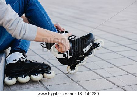 Closeup of man guy putting on roller skates