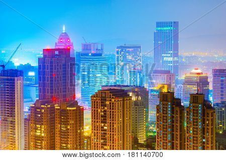 TAIPEI TAIWAN - MARCH 20: This is a view of Xinyi financial district skyscrapers and high rise buildings at night on March 20 2017 in Taipei