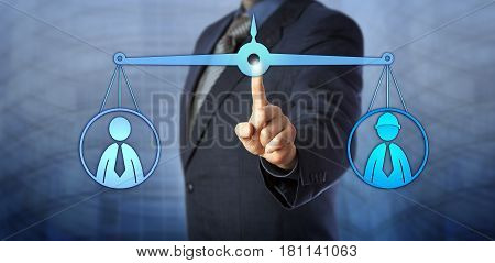 Blue chip manager mediating between a white collar employee and a blue collar worker. Both staff icons do balance out on a virtual weighing scale. Concept for conflict mediation performance review.