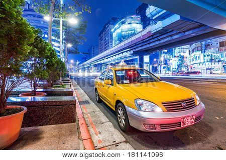 TAIPEI TAIWAN - MARCH 12: This is a taxi waiting outside Zhongxiao Fuxing station in downtown Taipei area at night on March 12 2017 in Taipei