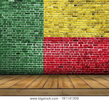 Benin flag painted on brick wall with wooden floor