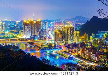 View of New Taipei city buildings at night from a mountain in Xindian