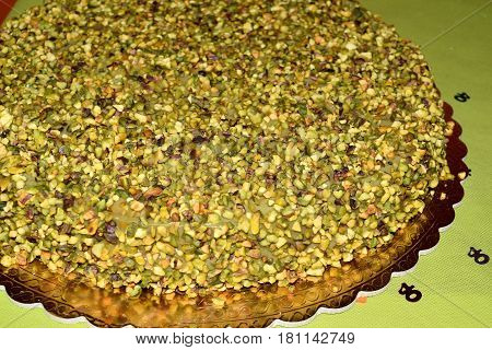 Chocolate Cake Topped With Chopped Pistachios And Pistachio Cream