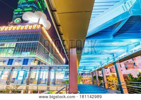 TAIPEI TAIWAN - FEBRUARY 16: This is a footbridge leading into the Taipei 101 shopping mall in Xinyi financial district at night on Februrary 16 2017 in Taipei