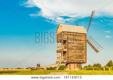 Large Russian wooden mill. Rear view. Summer rural landscape.