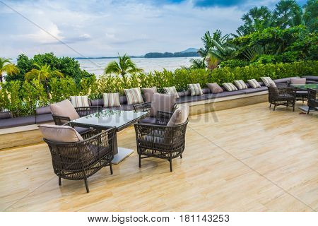 Table and chairs at restaurant in tropical sea