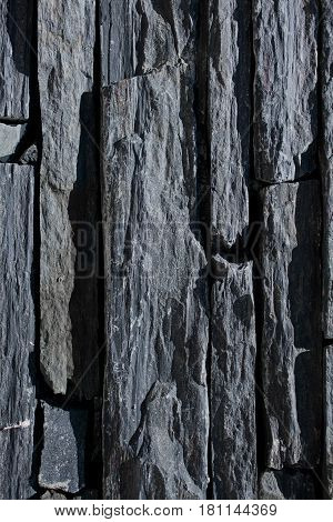 Stone wall texture. Rock wall background. Abstract texture and background for designers. Close up view of rock bricks. Stone wall macro view. Solid stone wall.