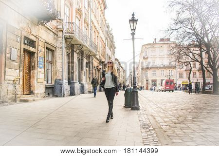 woman tourist walking on the street in old city