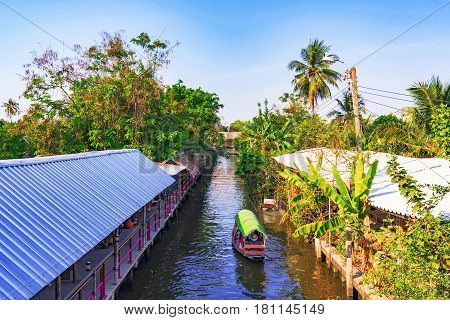 View of a canal in a rural jungle setting in Thailand