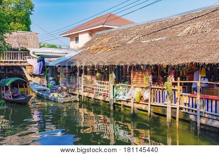 BANGKOK THAILAND - FEBRUARY 05: This is the canal in Klong Lat Mayom floating market in Bangkok where boats sell goods to people by the river on February 05 2017 in Bangkok