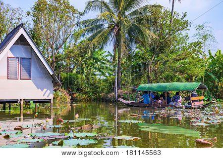 BANGKOK THAILAND - FEBRUARY 05: Boat and countryside house in the floating market area of Klong lat mayom February 05 2017 in Bangkok