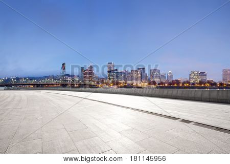 empty brick floor with cityscape of portland
