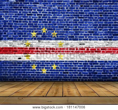 Cape Verde flag painted on brick wall with wooden floor