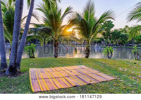 Exotic sunset scene by the lake in Chatuchak park in Bangkok