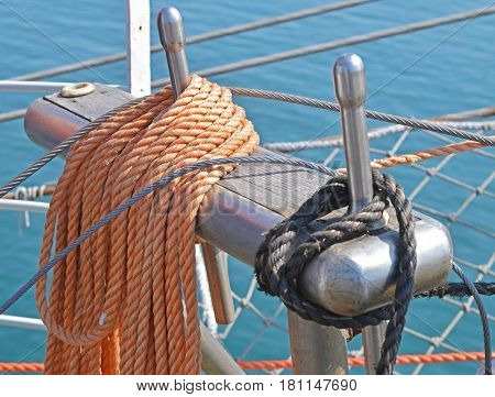 Reeled ship ropes hanging on the spools