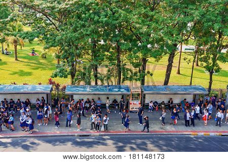 BANGKOK THAILAND - FEBRUARY 04: This is a busy bus stop outside Chatuchak park in the Mo chit area which is popular for its Chatuchak weekend market and is often very crowded on February 04 2017 in Bangkok