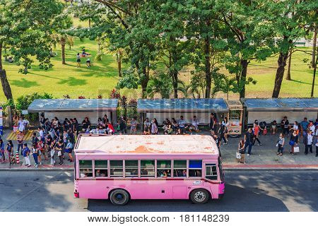 BANGKOK THAILAND - FEBRUARY 04: This is a busy bus stop outside Chatuchak park in the Mo chit area which is popular for its Chatuchak market and is often very crowded on February 04 2017 in Bangkok