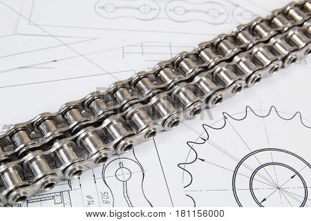 Technical engineering drawing roller drive industrial chain sprocket and mechanisms. Mechanical engineering technology of metal processing.Engineer working.