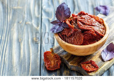 Purple Basil And Sun-dried Tomatoes In A Wooden Bowl.