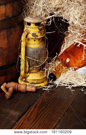 Whiskey Bottles.kerosene Lantern Style Oil Lamps, Wooden Barrel. Still Life. Copy Space.