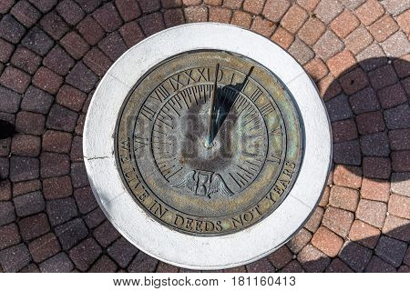 A sundial shows the time in the early afternoon.