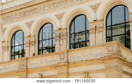 BUCHAREST ROMANIA - APR 1 2016: Business woman talking on mobile phone at the terrace of the Luxury Novotel Hotel Novotel Bucharest City Centre on Calea Victoriei