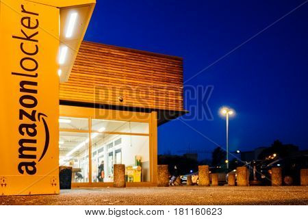PARIS FRANCE - FEB 15 2017: Amazon locker orange delivery package locker at dusk - Amazon Locker is a self-service parcel delivery service offered by online retailer Amazon.com.