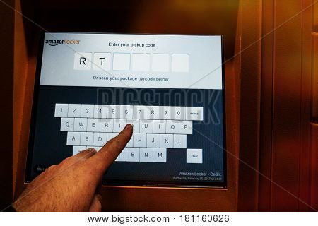 PARIS FRANCE - FEB 15 2017:Point of view of customer looking at the Amazon Locker digital touchscreen - Amazon Locker is a self-service parcel delivery service offered by online retailer Amazon.com. Amazon customers can select any Locker location as their