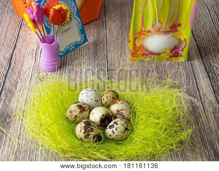 Colored different Easter eggs table decoration with postcard