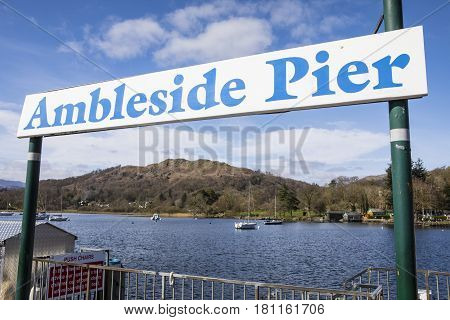 The sign for Ambleside Pier on Lake Windermere in the Lake District UK.