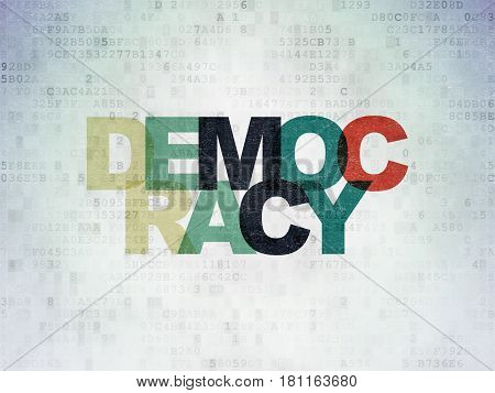Politics concept: Painted multicolor text Democracy on Digital Data Paper background