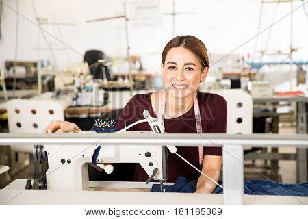 Beautiful Seamstress Enjoying Her Job