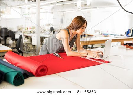 Fashion Designer Working In A Factory