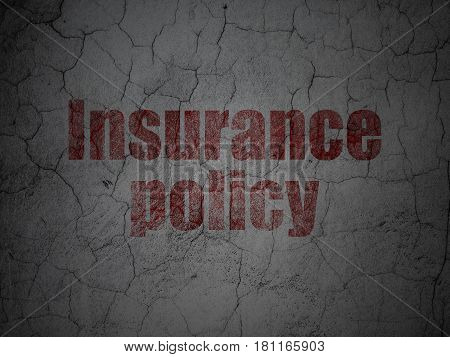 Insurance concept: Red Insurance Policy on grunge textured concrete wall background