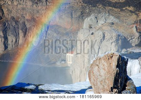 Rainbow above the river at Shoshone Falls