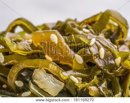 Extreme close up view of kelp seaweed salad with sesame seeds